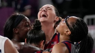 United States' Stefanie Dolson, top, celebrates with teammates Jacquelyn Young, left, Kelsey Plum and Allisha Gray, right, after defeating Russian Olympic Committee in a women's 3-on-3 gold medal basketball game at the 2020 Summer Olympics, Wednesday, July 28, 2021, in Tokyo, Japan.