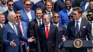 U.S. President Joe Biden laughs as quarterback Tom Brady jokes while speaking as the 2021 NFL Super Bowl champion Tampa Bay Buccaneers are welcomed to the South Lawn of the White House on July 20, 2021 in Washington, DC.