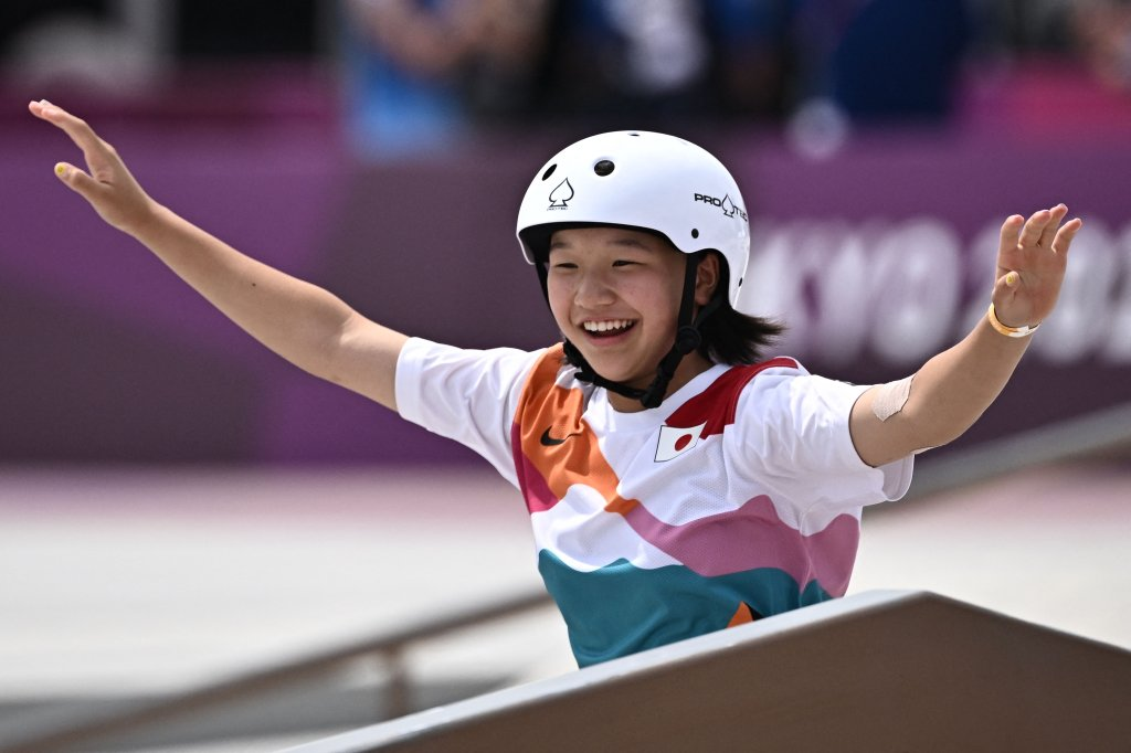 Japan's Momiji Nishiya celebrates after performing a trick during the skateboarding women's street final of the Tokyo 2020 Olympic Games at Ariake Sports Park in Tokyo on July 26, 2021.