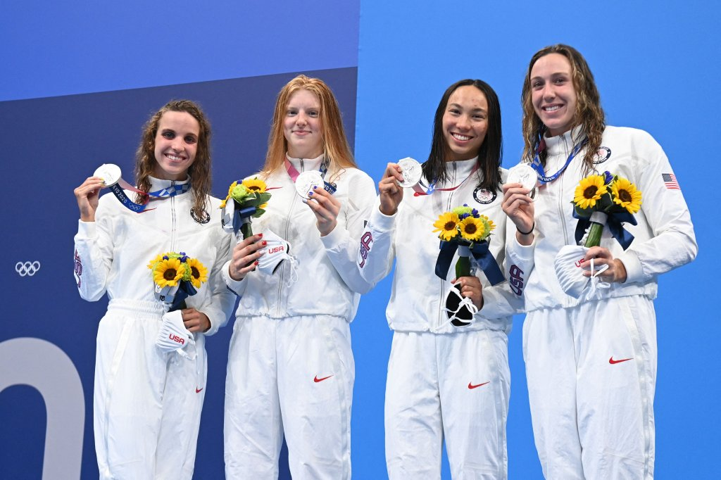 Silver medallists (from L) USA's Regan Smith, USA's Lydia Jacoby, USA's Torri Huske and USA's Abbey Weitzeil pose with their medals after the final of the women's 4x100m medley relay swimming event during the Tokyo 2020 Olympic Games at the Tokyo Aquatics Centre in Tokyo on August 1, 2021.