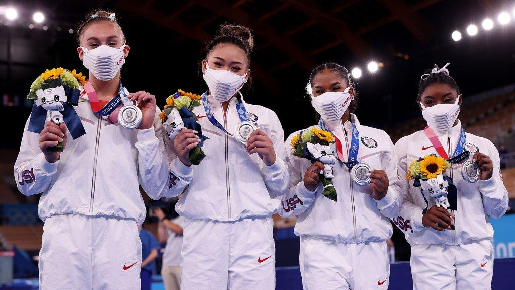 women's gymnastics team shows off silver medals
