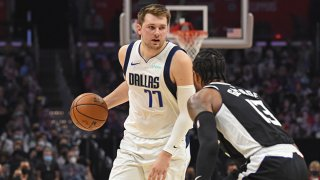 FILE: Luka Doncic #77 of the Dallas Mavericks handles the ball against Paul George #13 of the LA Clippers during Round 1, Game 7 of the 2021 NBA Playoffs on June 6, 2021 at STAPLES Center in Los Angeles, California.