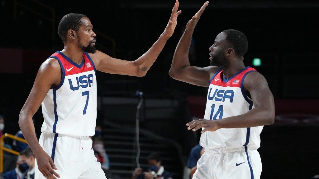 Jul 28, 2021; Saitama, Japan; USA player Kevin Durant (7) and USA player Draymond Green (14) high five as they play Iran during the Tokyo 2020 Olympic Summer Games at Saitama Super Arena.