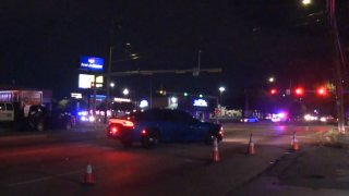 One person was hit and killed Friday night by a driver suspected of running a red light after fleeing from officers, Arlington police say.