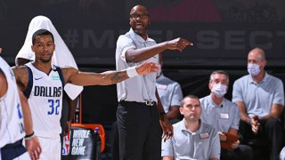FILE: Jamahl Mosley of the Dallas Mavericks coaches against the Milwaukee Bucks on August 8, 2020 in Orlando, Florida at AdventHealth Arena.
