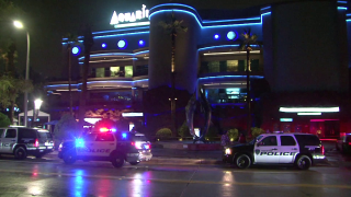 Two men died and a woman was wounded in what Houston police said was a murder-suicide at a downtown seafood restaurant.