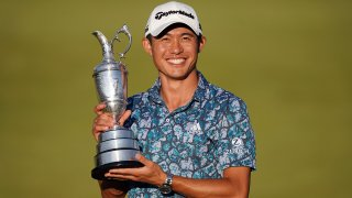 Jul 18, 2021; Sandwich, England, GBR; Collin Morikawa celebrates with the Claret Jug on the 18th green following his final round winning the Open Championship golf tournament.