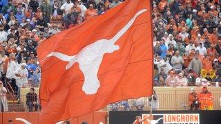 A Texas Longhorns spirit member runs with a flag during game against the Texas Tech Red Raiders on November 29, 2019 at Darrell K Royal-Texas Memorial Stadium in Austin, Texas.