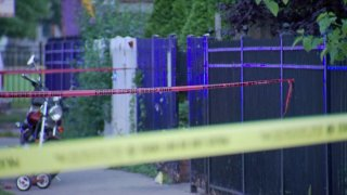 Yellow and red strands of crime scene tape are seen near the area where a toddler was shot in Chicago's Humboldt Park neighborhood