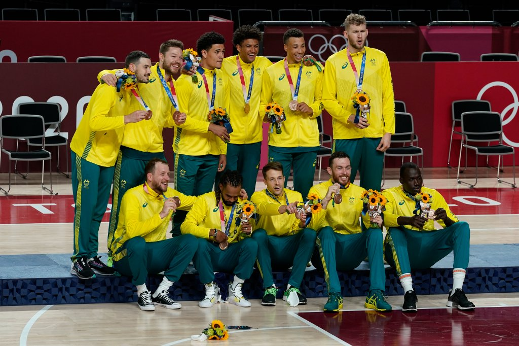 Australia poses for photos on the podium with their bronze medals after beating Slovenia during the Men's Basketball bronze medal game at the 2020 Olympics, Saturday, Aug. 7, 2021, in Tokyo, Japan.