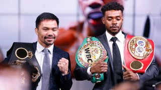 Manny Pacquiao and Errol Spence Jr pose for the media following their press conference at Fox Studios on July 11, 2021 in Los Angeles, California. Their fight is scheduled on Aug. 21, 2021 at T-Mobile Arena in Las Vegas, Nevada.