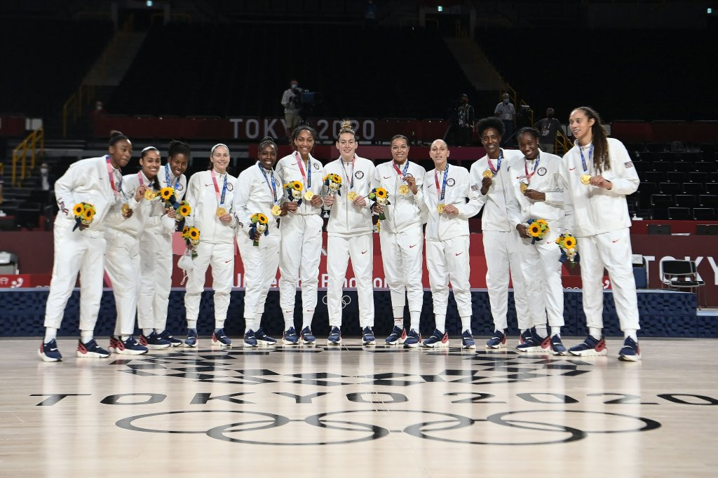 First placed USA's players pose for pictures with their gold medals after the medal ceremony for the women's basketball competition of the Tokyo 2020 Olympic Games at the Saitama Super Arena in Saitama on Aug. 8, 2021.