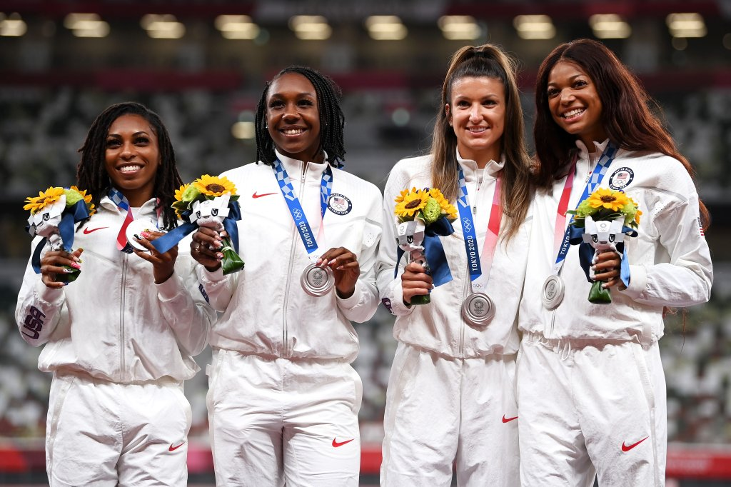 Silver medal winners Javianne Oliver, Teahna Daniels, Jenna Prandini and Gabrielle Thomas of Team United States stand on the podium during the medal ceremony for the Women's 4x100-Meter Relay on day 15 of the Tokyo 2020 Olympic Games at Olympic Stadium on Aug. 7, 2021, in Tokyo, Japan.