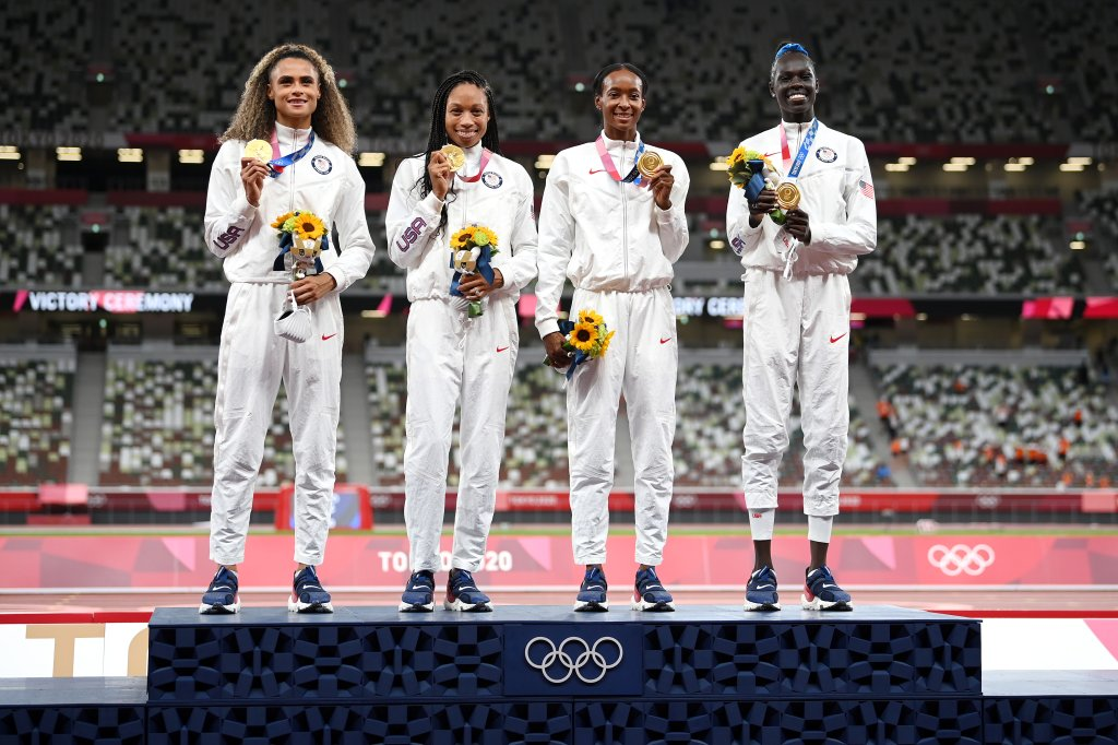 Gold medalists Allyson Felix, Athing Mu, Dalilah Muhammad and Sydney McLaughlin of Team United States stand on the podium during the medal ceremony for the Women's 4x400m Relay on day fifteen of the Tokyo 2020 Olympic Games at Olympic Stadium on Aug. 7, 2021 in Tokyo, Japan.