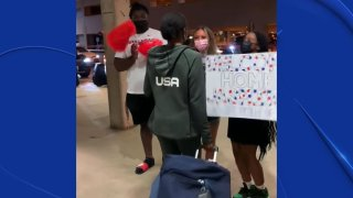 Olympian Jasmine Moore is back in North Texas. While she didn't have a moment on the podium, her family and friends welcomed her back with pride.