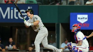 Matt Chapman #26 of the Oakland Athletics hits a home run in the seventh inning against the Texas Rangers at Globe Life Field on Aug. 14, 2021 in Arlington, Texas.