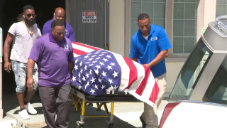 Family and friends of a New Orleans police officer who was shot and killed during a restaurant holdup while vacationing with friends in Houston are gathering Friday to remember him.