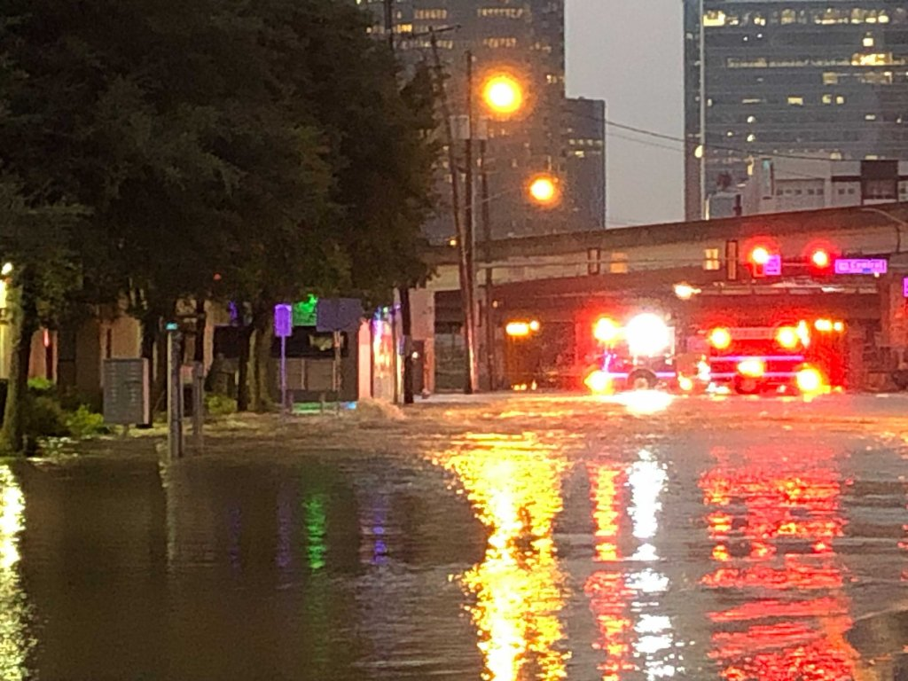 Ross Avenue near US Highway 75 in Dallas looks more like a river Wednesday night as thousands of gallons of water filled the street.