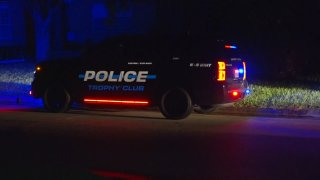 A man was taken into custody late Wednesday in connection with a reported kidnapping after a standoff in a Trophy Club neighborhood.
