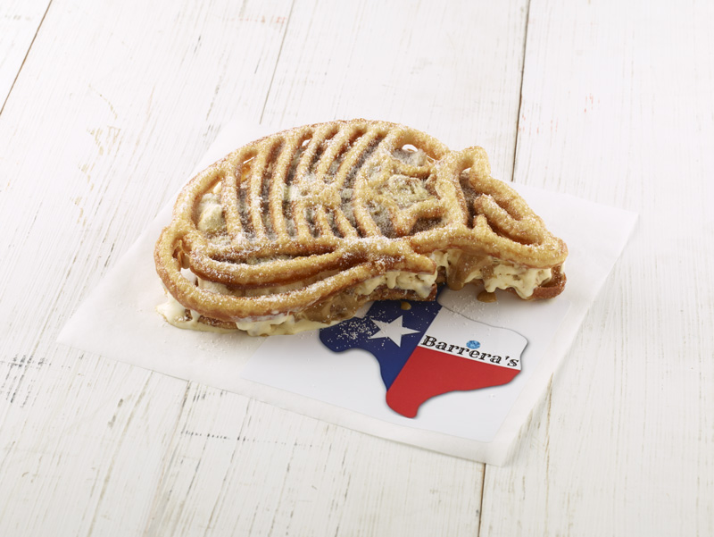 Y'all will want to go home with the Armadillo Cookie Butter Ice Cream Sandwich! It is a made-from-scratch cookie butter semifreddo – an Italian take on ice cream that means semi-frozen. The treat is drizzled with cookie butter and sandwiched between two deep fried Armadillo-shaped cookies that are made with a branding iron. Finally, it is dusted with buttery sugar. Absolutely a velvety cream delight!