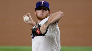 A.J. Alexy of the Texas Rangers makes his Major League debut pitching against the Colorado Rockies in the top of the first inning at Globe Life Field on Aug. 30, 2021 in Arlington, Texas.