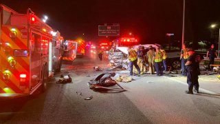 A crash involving a fire truck and a pickup truck closed a portion of Interstate 35E in Denton Thursday morning.