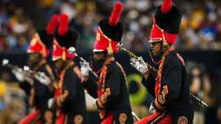 """The drum majors of Grambling State """"World Famed"""" Band march into position during the 45th annual State Farm Bayou Classic game between the Southern Jaguars and the Grambling State Tigers on Saturday November 24, 2018 at the Mercedes-Benz Super Dome in New Orleans, Louisiana."""