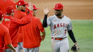 Jo Adell #7 of the Los Angeles Angels celebrates their 11-3 win over the Texas Rangers at Globe Life Field on Aug. 3, 2021 in Arlington, Texas.