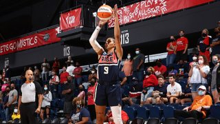 Natasha Cloud #9 of the Washington Mystics shoots a three point basket during the game against the Dallas Wings on Aug. 28, 2021 at Entertainment & Sports Arena in Washington, DC.