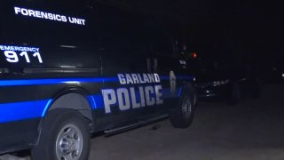 A man accused of murder was arrested after a hours-long standoff with Garland officers, police said.