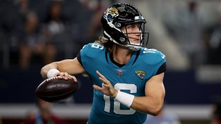 Quarterback Trevor Lawrence #16 of the Jacksonville Jaguars looks for an open receivers against the Dallas Cowboys in the first quarter of the NFL preseason game at AT&T Stadium on Aug. 29, 2021 in Arlington, Texas.