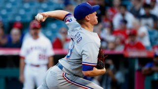 Texas Rangers starting pitcher Kolby Allard throws to a Los Angeles Angels batter during the first inning of a baseball game in Anaheim, Calif., Saturday, Sept. 4, 2021.