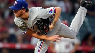 Texas Rangers starting pitcher A.J. Alexy throws to the Los Angeles Angels