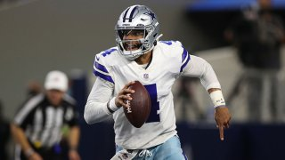 Dak Prescott #4 of the Dallas Cowboys looks for a open receiver in the first half while playing the Philadelphia Eagles at AT&T Stadium on Sept. 27, 2021 in Arlington, Texas.