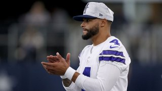 Quarterback Dak Prescott #4 of the Dallas Cowboys looks on from the sidelines as the Dallas Cowboys take on the Houston Texans in the first quarter of a preseason NFL game at AT&T Stadium on Aug. 21, 2021 in Arlington, Texas.