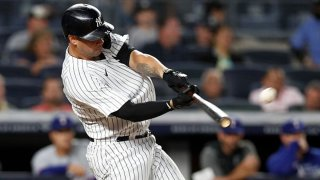 Gary Sanchez #24 of the New York Yankees connects on a second inning home run against the Texas Rangers at Yankee Stadium on Sept. 20, 2021 in New York City.