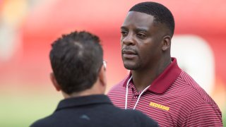 LANDOVER, MD - AUGUST 15: Former Washington Redskins running back Clinton Portis looks on from the sidelines prior to the NFL preseason game between the Cincinnati Bengals and Washington Redskins on August 15, 2019, at FedEx Field in Landover, MD.