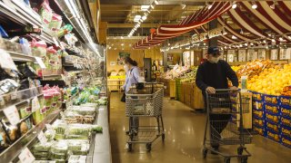 Customers wearing protective masks shop at a Stew Leonard's supermarket in Paramus, New Jersey