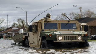A National Guard vehicle drives through floodwater left behind by Hurricane Ida in LaPlace, Louisiana on Monday, Aug. 30, 2021.