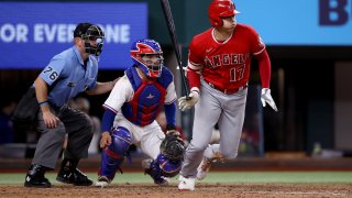 Shohei Ohtani #17 of the Los Angeles Angels runs to first base on a ground out ball against the Texas Rangers in the top of the seventh inning at Globe Life Field on September 29, 2021 in Arlington, Texas.