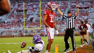 Wide receiver Jadon Haselwood #11 of the Oklahoma Sooners celebrates a touchdown against cornerback Ronald Kent #13 of the Western Carolina Catamounts late in the second quarter at Gaylord Family Oklahoma Memorial Stadium on September 11, 2021 in Norman, Oklahoma. Oklahoma leads 45-0 at the half.