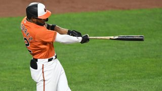 Kelvin Gutierrez #82 of the Baltimore Orioles hits a two run home run in the seventh inning during a baseball game against the Texas Rangers at Oriole Park at Camden Yards on Sept. 25, 2021 in Baltimore, Maryland.