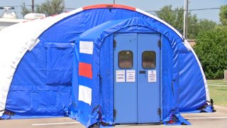 A blue tent set up outside the Rockwall County Courthouse could be the tool they need to curb COVID-19 hospitalizations.