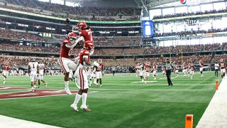 AJ Green #0 of the Arkansas Razorbacks celebrates with teammate Ketron Jackson Jr. #2 after scoring on a touchdown pass against the Texas A&M Aggies in the first half of the Southwest Classic at AT&T Stadium on Sept. 25, 2021 in Arlington, Texas.
