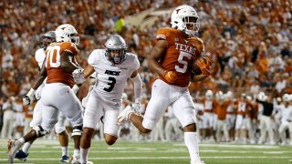 Bijan Robinson #5 of the Texas Longhorns rushes for a touchdown in the second quarter against the Rice Owls at Darrell K Royal-Texas Memorial Stadium on Sept. 18, 2021 in Austin, Texas.