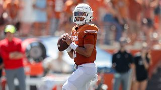 Casey Thompson #11 of the Texas Longhorns looks to pass in the first half against the Texas Tech Red Raiders at Darrell K Royal-Texas Memorial Stadium on Sept. 25, 2021 in Austin, Texas.