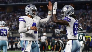 CeeDee Lamb #88 of the Dallas Cowboys celebrates his second half touchdown with Dak Prescott #4 while playing the Philadelphia Eagles at AT&T Stadium on Sept. 27, 2021 in Arlington, Texas.