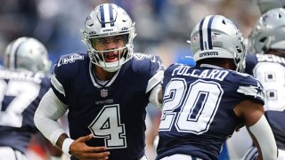 Quarterback Dak Prescott (4) of the Dallas Cowboys hands the ball to running back Tony Pollard (20) of the Dallas Cowboys during the first quarter in the game against the Los Angeles Chargers at SoFi Stadium on Sept. 19, 2021 in Inglewood, California.