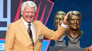 Class of 2020 member Jimmy Johnson celebrates with a bust of Johnson during the Pro Football HOF Centennial Class of 2020 enshrinement ceremonies on Aug. 7, 2021 at Tom Benson Hall of Fame Stadium, in Canton, Ohio.