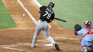 Jose Abreu #79 of the Chicago White Sox singles, driving in two runs against the Texas Rangers during the fourth inning at Globe Life Field on Sept. 19, 2021 in Arlington, Texas.